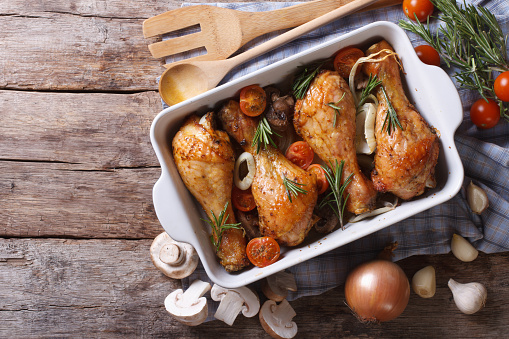 Baked chicken legs with mushrooms and vegetables. horizontal top 480462346