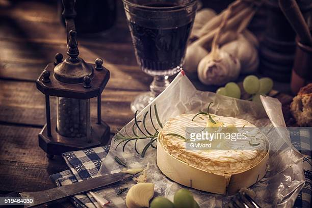 baked creamy and soft camembert cheese - camembert stock photos and pictures