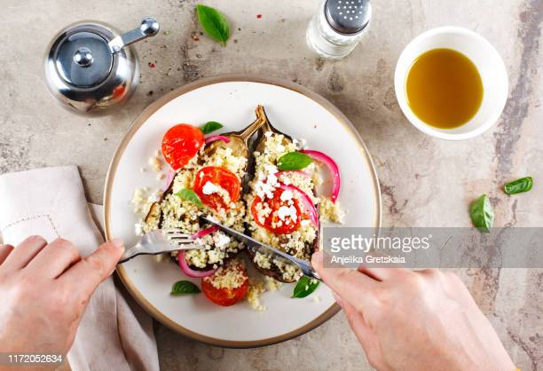 baked eggplant stuffed with couscous, tomatoes, feta and basil leaves - mediterranean food stock pictures, royalty-free photos & images