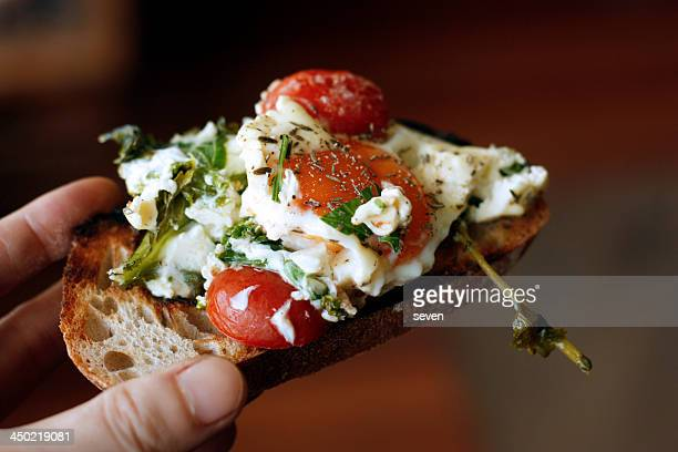 baked eggs with feta cheese - greek food stock pictures, royalty-free photos & images