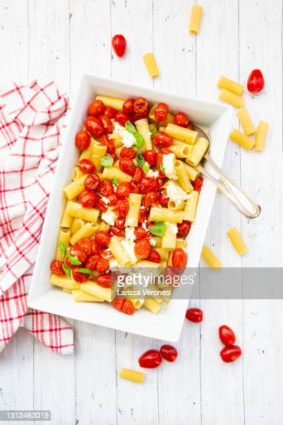 baked feta pasta with tomatoes - feta cheese stock pictures, royalty-free photos & images