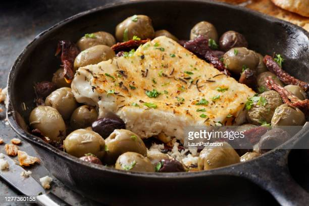 baked feta with olives, garlic and sun dried tomatoes - kalamata olive stock pictures, royalty-free photos & images