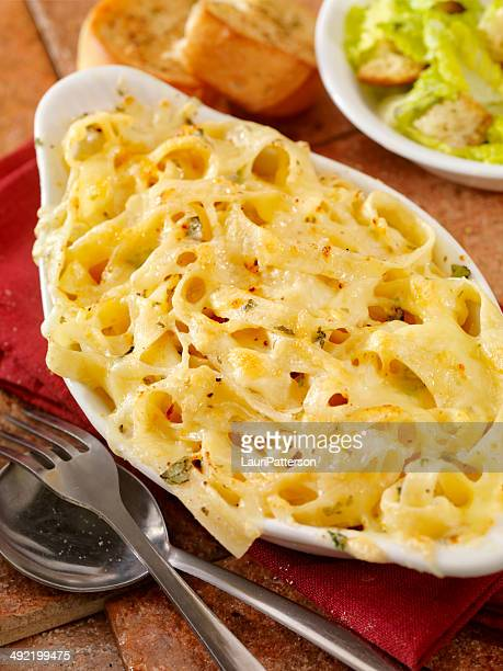 baked fettucini in alfredo sauce - bechamel sauce stock photos and pictures