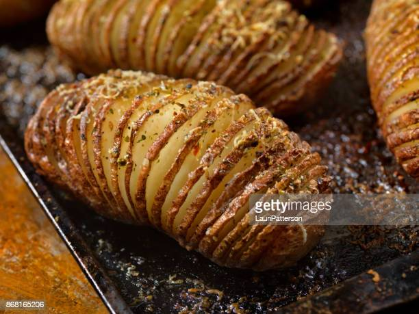 baked hasselback potatoes - prepared potato stock pictures, royalty-free photos & images