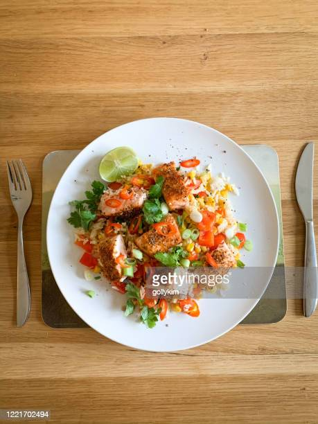 baked mexican spice salmon with coconut and lime rice - elevated view stock pictures, royalty-free photos & images