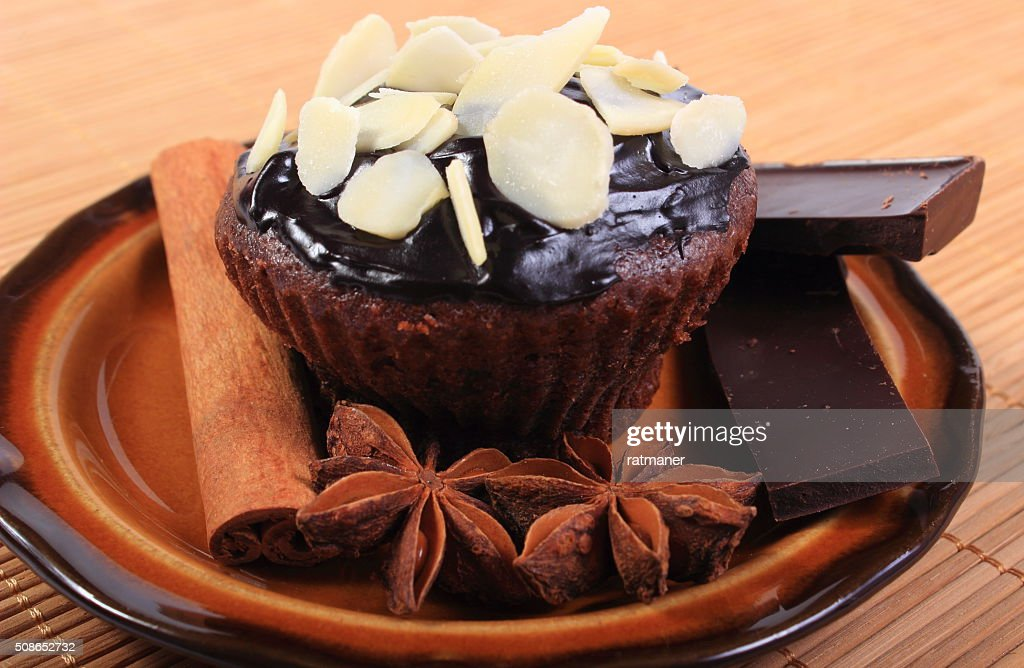 Baked muffins with pieces of chocolate, anise and cinnamon : Stock Photo