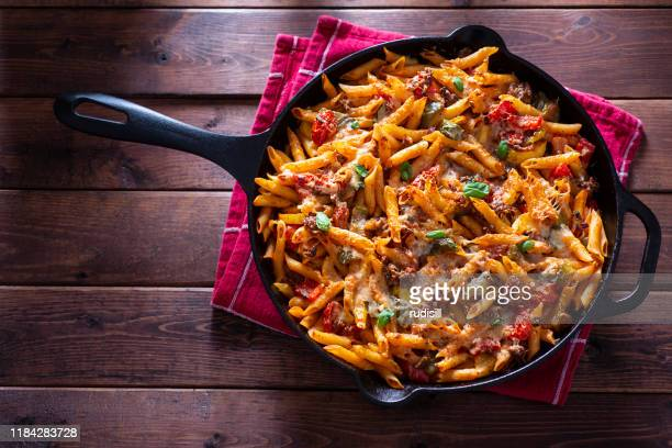 baked pasta skillet - sausage stock pictures, royalty-free photos & images