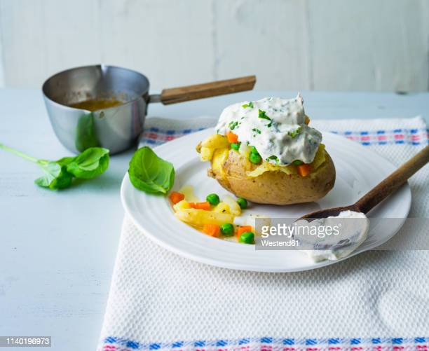 Baked patato with curd, asparagus, peas and carrots