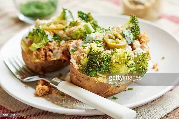Baked potato with broccoli, soy yogurt and vegan parmesan cheese