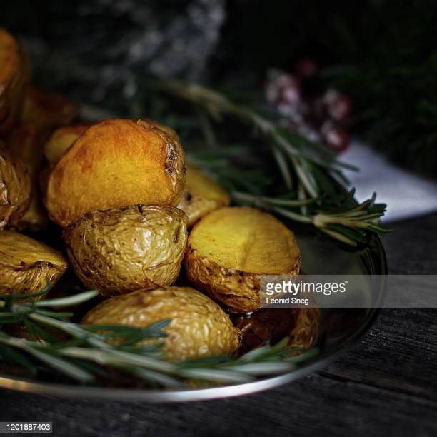 baked potato with rosemary and spices close-up on a dark wooden background - prepared potato stock pictures, royalty-free photos & images