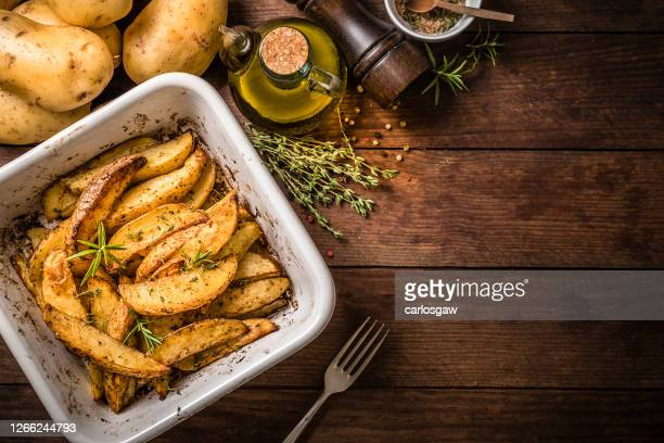 baked potatoes on a baking sheet - prepared potato stock pictures, royalty-free photos & images