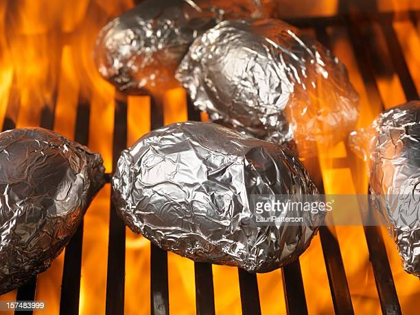 baked potatoes on the bbq - prepared potato stock pictures, royalty-free photos & images
