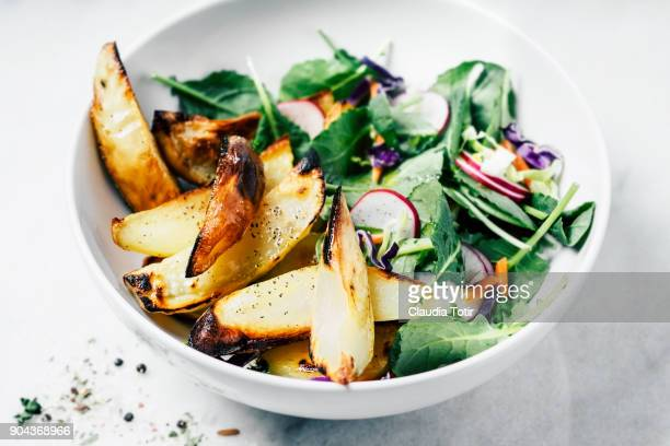 baked potatoes with green salad - ローストポテト ストックフォトと画像