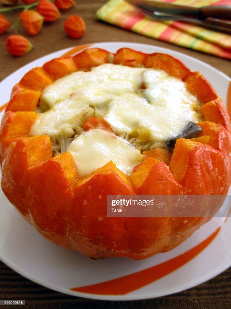Baked pumpkin stuffed with vegetables and mozzarella : Stock Photo