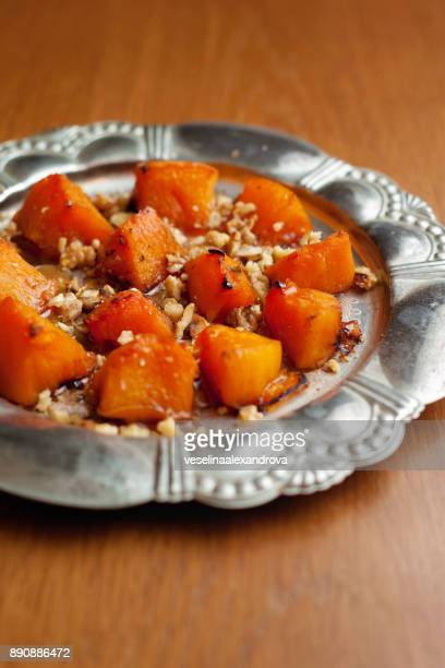 Baked pumpkin with walnuts and honey