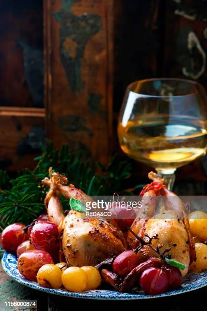 Baked quails with grapes style rustic selective focus
