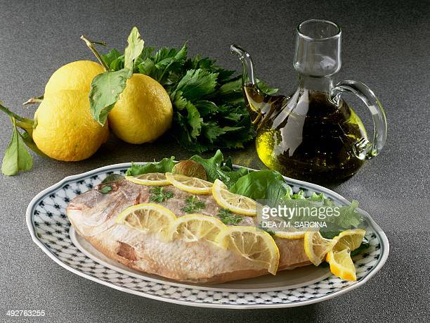 Baked red snapper seasoned with olive oil and lemon