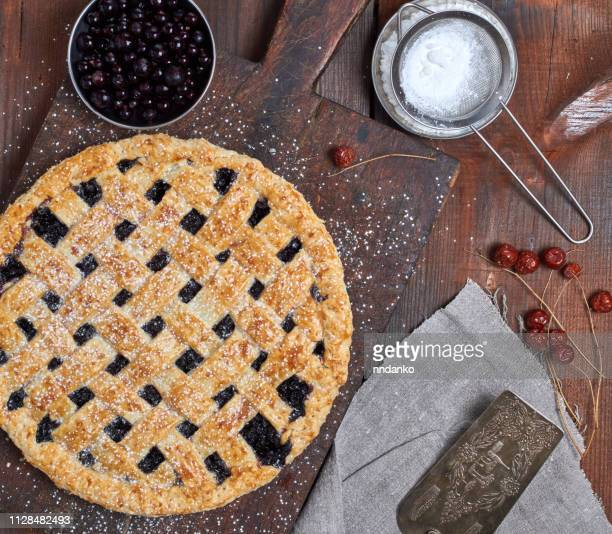 baked round black currant cake wooden