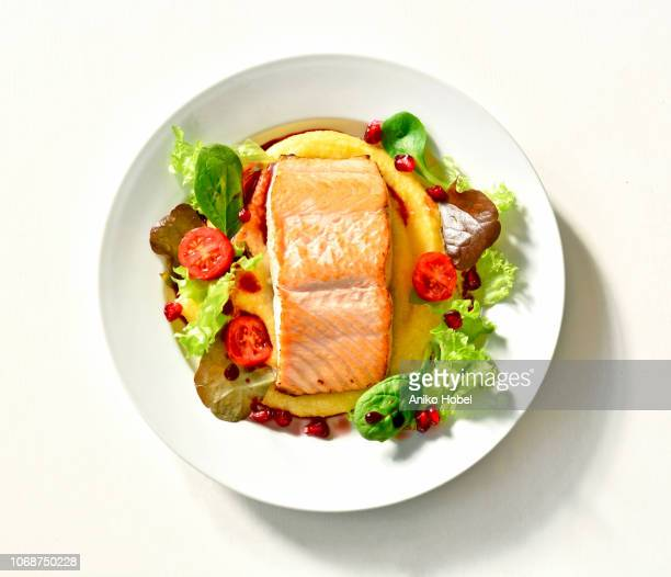 baked salmon on polenta - salmon seafood stock pictures, royalty-free photos & images