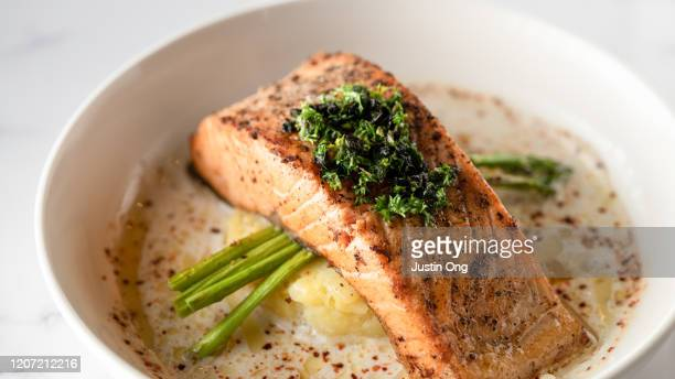 baked salmon with mashed potato and asparagus, creamy sauce - 鮭料理 ストックフォトと画像