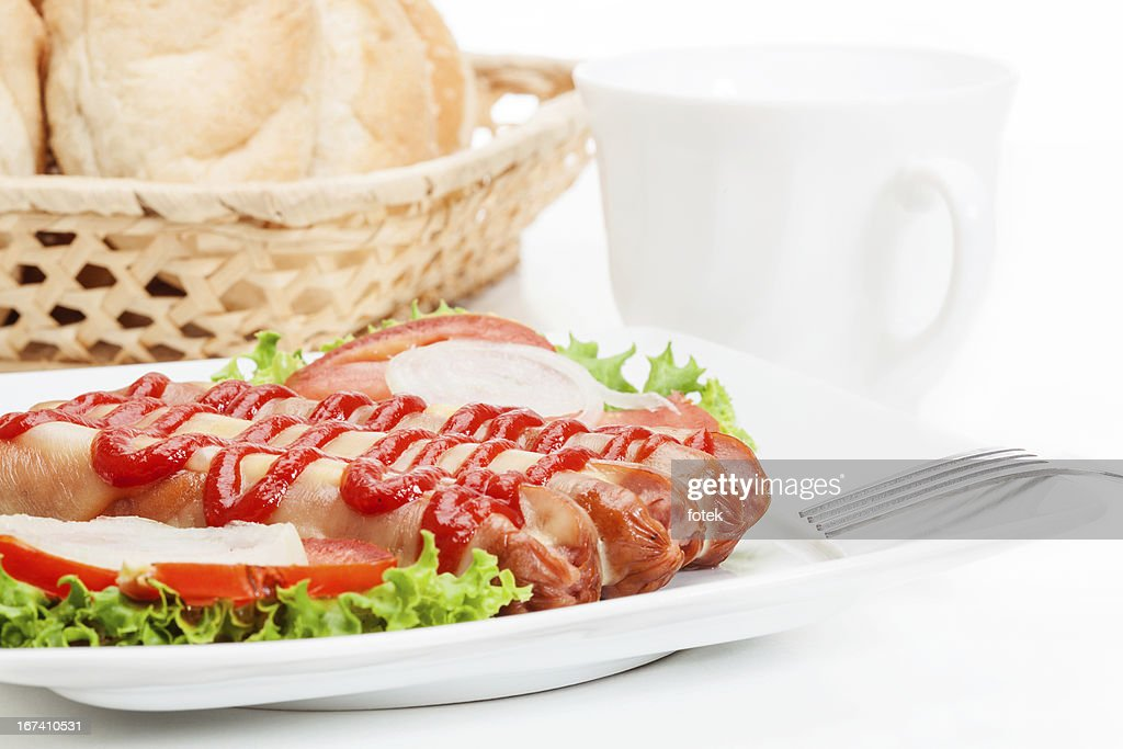 Baked sausage witch cheese : Stock Photo