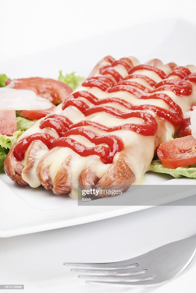 Baked sausage witch cheese : Stockfoto