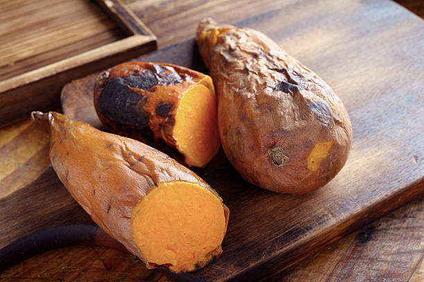 baked sweet potato - sweet potatoes stock pictures, royalty-free photos & images