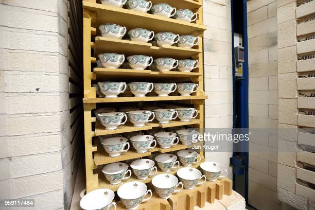 Baked tea cups for the production of special edition crockery ahead of the wedding of Prince Harry and Meghan Markle at William Edwards Home Ltd on...