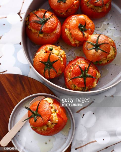 baked tomatoes stuffed with risotto - スタッフィング ストックフォトと画像