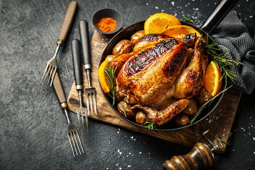 Baked whole chicken with spices on pan 1148174843