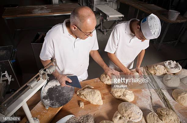 Baker and his son in bakery