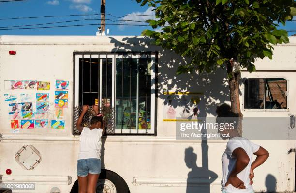 Baker and Wendy Bigesby get ice cream from the neighborhood truck in Northeast Washington DC on July 18 2018 This is the truck the slain 10yearold...
