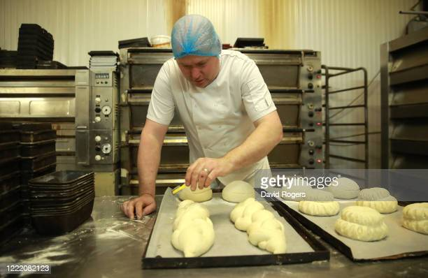 Baker Andy Collins prepares loaves for the oven at Whittlebury Bakery on April 30 2020 in Whittlebury England British Prime Minister Boris Johnson...