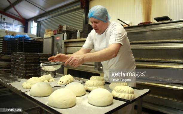 Baker Andy Collins sprinkles flour as he prepares loaves for the oven at Whittlebury Bakery on April 30 2020 in Whittlebury England British Prime...