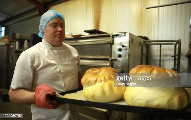 Baker Andy Collins takes out freshly baked loaves from the oven at Whittlebury Bakery on April 30 2020 in Whittlebury England British Prime Minister...