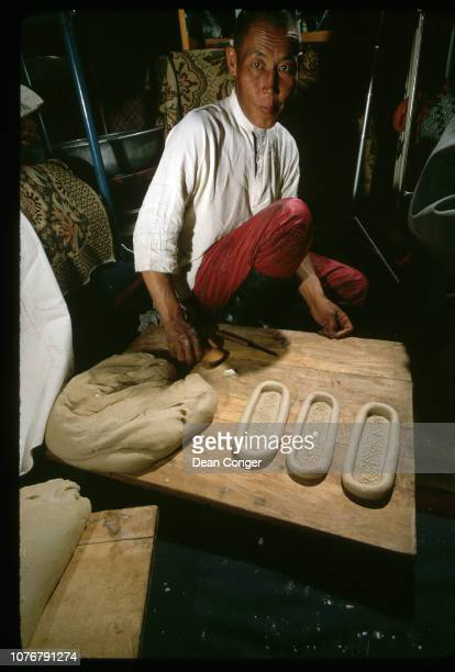 Baker Displaying Bread Boats
