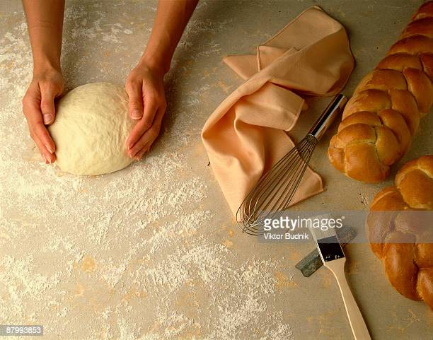 Baker forming a boule from bread dough