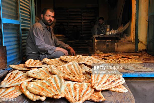 Baker in Kabul's market, Afghanistan