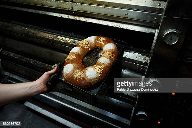 Baker Jose Luis Ruiz 32 bakes 'Roscon de Reyes' at the Antigua Pasteleria del Pozo ahead of the Three Kings Day on January 3 2017 in Madrid Spain...