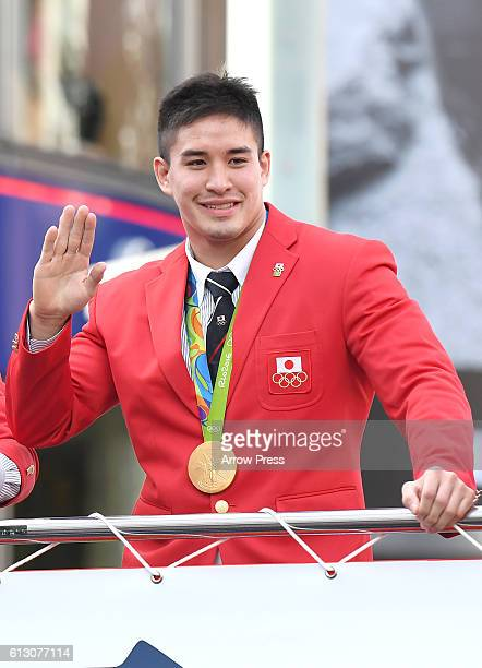 Baker Mashu waves on the top of a double decker bus during the Rio Olympic Paralympic 2016 Japanese medalist parade in the ginza district on October...