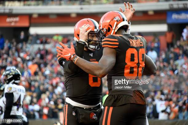 Baker Mayfield and Demetrius Harris of the Cleveland Browns celebrate after scoring a touchdown against the Baltimore Ravens during the second...