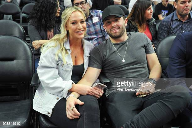 Baker Mayfield and Emily Wilkinson attends a basketball game beween the Los Angeles Clippers and the New Orleans Pelicans at Staples Center on March...