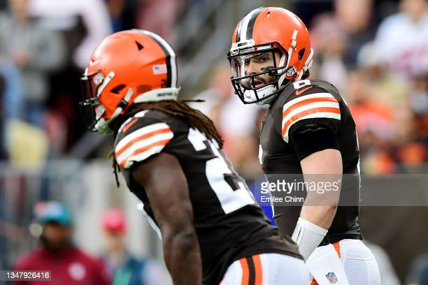 Baker Mayfield and Kareem Hunt of the Cleveland Browns prepare for the play during a game against the Arizona Cardinals at FirstEnergy Stadium on...