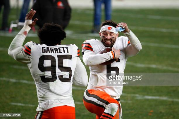 Baker Mayfield and Myles Garrett of the Cleveland Browns celebrate a victory over the Pittsburgh Steelers in the AFC Wild Card Playoff game at Heinz...