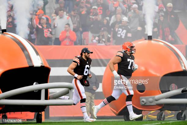 Baker Mayfield and Wyatt Teller of the Cleveland Browns take the field for a game against the Arizona Cardinals at FirstEnergy Stadium on October 17,...