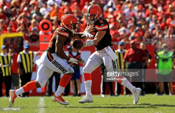 Baker Mayfield hands off to Nick Chubb of the Cleveland Browns during a game against the Tampa Bay Buccaneers at Raymond James Stadium on October 21...