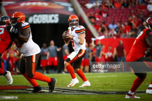 Baker Mayfield of the Cleveland Browns drops back to pass in the first quarter of the preseason game against the Tampa Bay Buccaneers at Raymond...