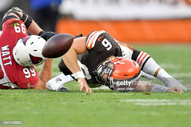 Baker Mayfield of the Cleveland Browns fumbles the ball after a tackle from J.J. Watt of the Arizona Cardinals during the third quarter at...