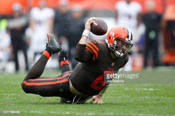 Baker Mayfield of the Cleveland Browns hits the ground after being tripped in the third quarter against the Baltimore Ravens at FirstEnergy Stadium...