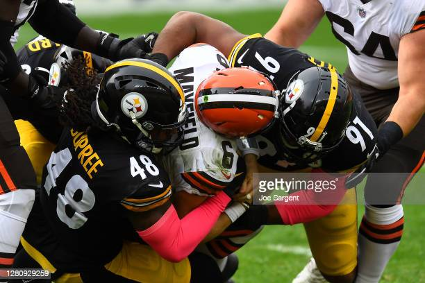 Baker Mayfield of the Cleveland Browns is sacked by Bud Dupree and Stephon Tuitt of the Pittsburgh Steelers during their NFL game at Heinz Field on...